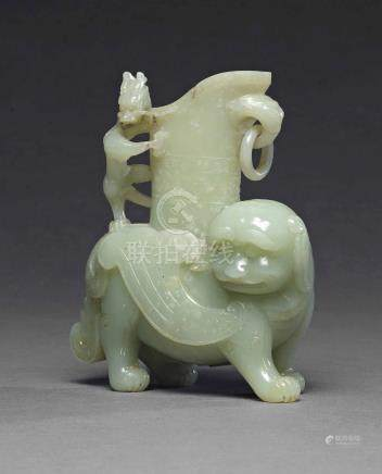 A WHITE JADE 'BUDDHIST LION AND DRAGON' VASEQIANLONG PERIOD (1736-1795)