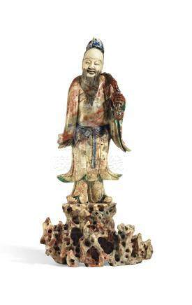 A LARGE POLYCHROME AND GILT-DECORATED SOAPSTONE FIGURE OF A DAOIST IMMORTAL18TH-19TH CENTURY