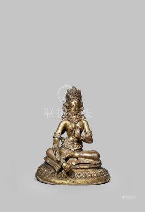 A TIBETO-CHINESE GILT COPPER REPOUSSE FIGURE OF GREEN TARA