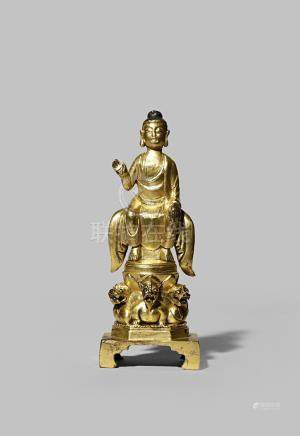 A CHINESE TANG-STYLE GILT BRONZE FIGURE OF BUDDHA