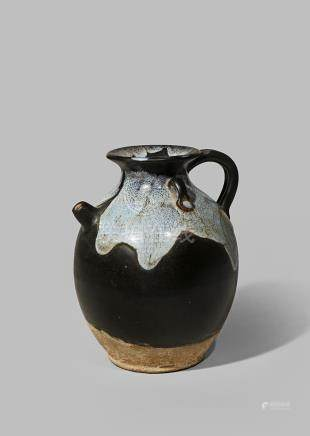 A CHINESE PHOSPHATIC GLAZED EWER