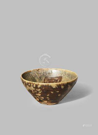 A CHINESE JIZHOU 'PAPER-CUT' BOWL