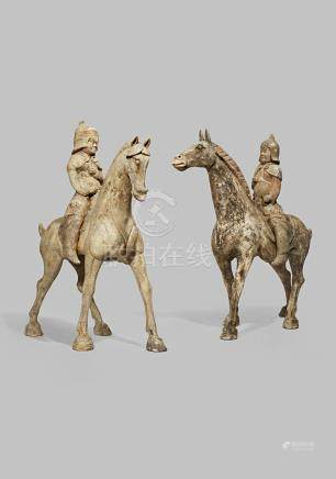A PAIR OF CHINESE POTTERY MODELS OF HORSES AND RIDERS