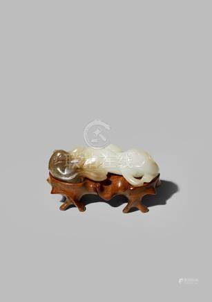 A CHINESE WHITE AND BROWN JADE CARVING OF TWO BADGERS