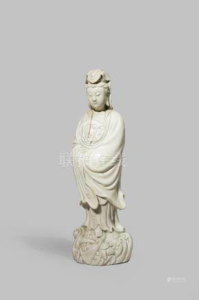 A LARGE CHINESE BLANC DE CHINE MODEL OF GUANYIN MARKED HE CHAO ZONG