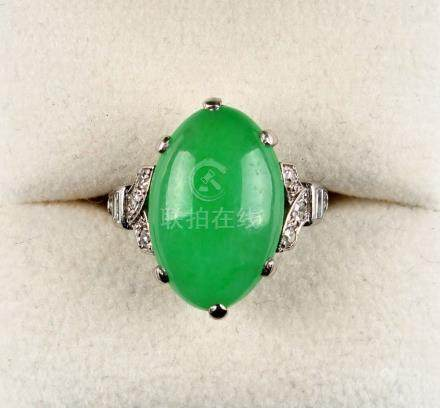 A platinum jadeite & diamond ring, the untreated oval cabochon jadeite measuring approximately 17.