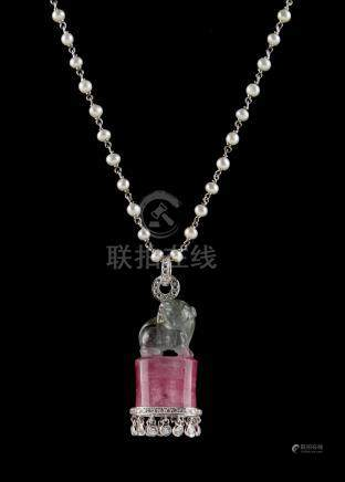 An unusual carved two-colour tourmaline pendant modelled as a Chinese temple lion on a pink