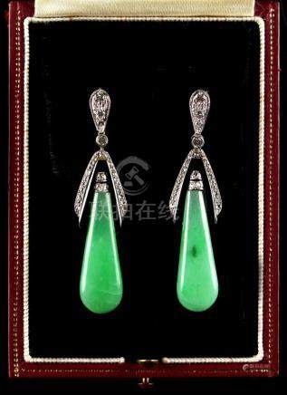 A pair of Art Deco style jadeite, black onyx & diamond pendant earrings, each 2.05ins. (5.2cms.)