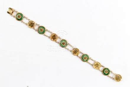 A Chinese 18ct yellow gold & jadeite circular panel bracelet, 7.6ins. (19.2ms.) long,