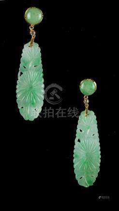 A pair of jadeite & diamond pendant earrings, each with a carved & pierced jadeite drop suspended
