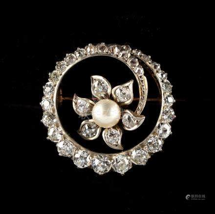 An early 20th century pearl & Old European cut diamond circular foliate brooch, 0.8ins. (2cms.)