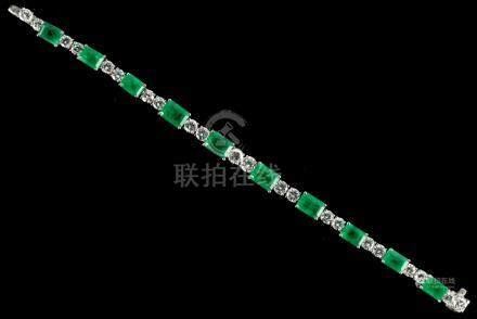 A fine 18ct white gold emerald & diamond bracelet, set with ten graduated rectangular cut emeralds