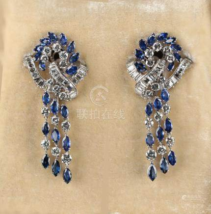 A very fine pair of 18ct white gold & platinum sapphire & diamond earrings, the navette cut