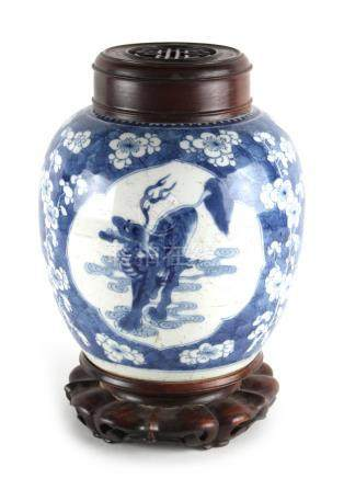 A Chinese blue & white ovoid jar, Kangxi period (1662-1722), with associated carved hongmu cover &
