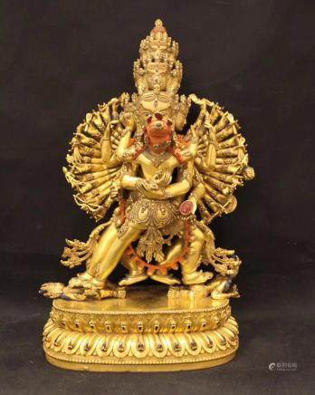 A MING BRONZE GLITED BUDDHA FIGURE