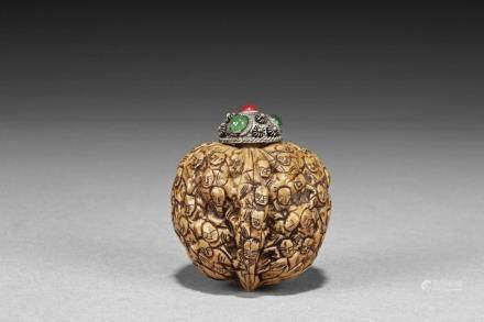 """A WALNUT-SHELL CARVED """"LUOHAN"""" SNUFF BOTTLE"""