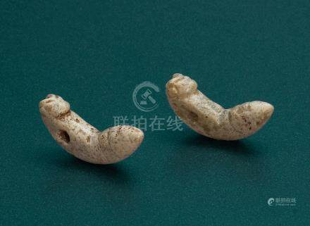 A PAIR OF JADE SILK WORM-FORM PENDANTS
