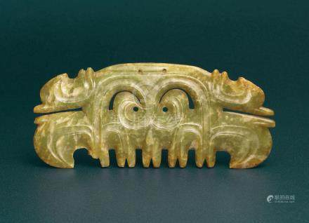 A VERY RARE GREEN JADE TOOTHED ANIMAL MASK ORNAMENT