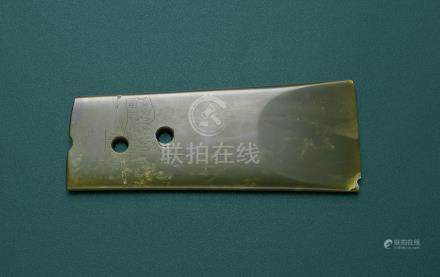 A GREEN JADE 'TIGER' CEREMONIAL AXE, YUE