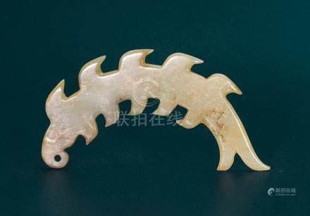 A JADE SERRATED FISH-FORM PENDANT