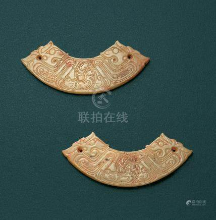 A PAIR OF CELADON JADE 'DRAGON' HUANG