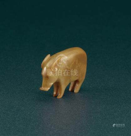 A VERY SMALL AND RARE JADE PIG