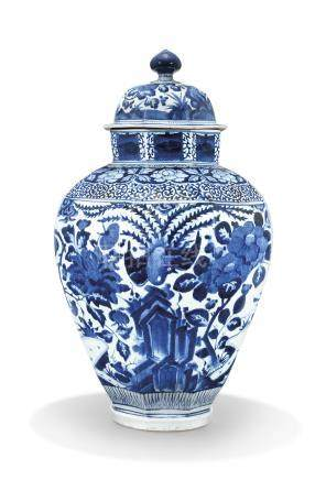 A LARGE JAPANESE ARITA BLUE AND WHITE OCTAGONAL JAR AND MARRIED COVER