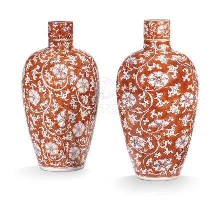 A PAIR OF CHINESE CORAL-GROUND REVERSE-DECORATED SLENDER JARS