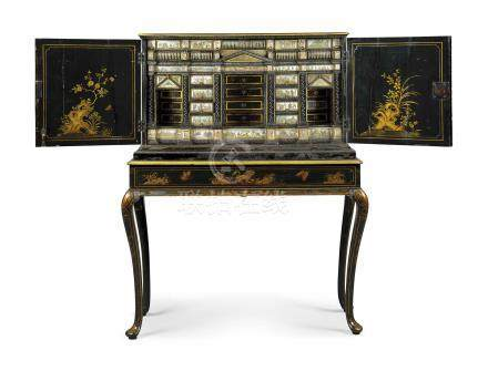 A NORTH EUROPEAN GILT-DECORATED JAPANNED CABINET ON STAND