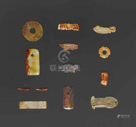 TWELVE SMALL JADE CARVINGS AND A BONE FRAGMENT