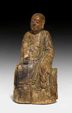 A FINE WOOD SCULPTURE OF A SEATED MONK