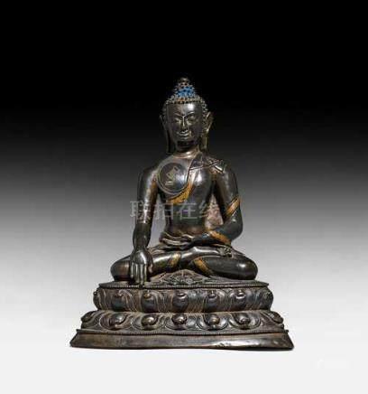 A BRONZE FIGURE OF BUDDHA SHAKYAMUNI WITH VAJRA.