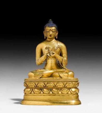 A GILT BRONZE FIGURE OF BUDDHA VAIROCANA.