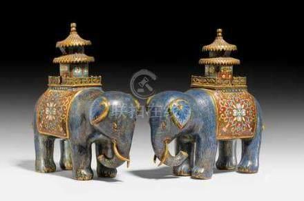 A PAIR OF BLUE CLOISONNE ENAMEL ELEPHANTS.