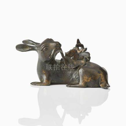 A RECUMBENT BRONZE HARE MIRROR STAND
