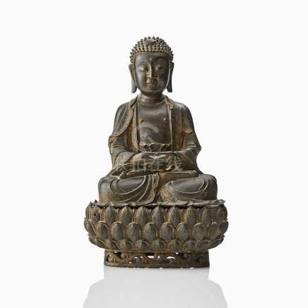 A BRONZE FIGURE OF A SEATED BUDDHA