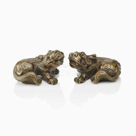 A PAIR OF BRONZE FO LIONS