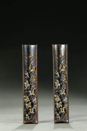 A pair of bronze silver inlaid 'immortals' paperweights