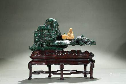 A malachite carved boulder with shoushan luohan