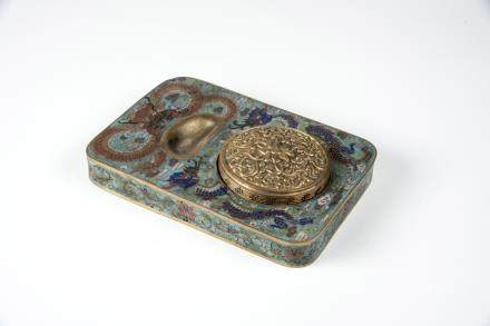 China, 19th C., cloisonné ink pad with a cover.  Qianlong mark.