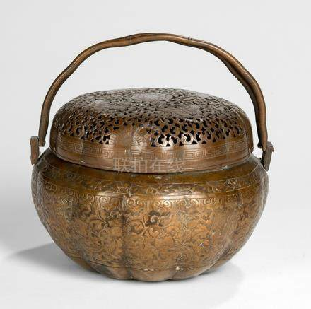 A FLORAL DECORATED COPPER REPOUSSé HANDWARMER, China, 19th ct. - Property from a German private collection, assembled in the 1980s and 90s - Small repair to handle