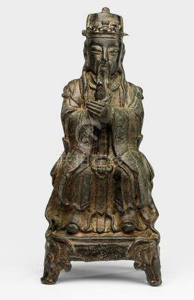 A BRONZE FIGURE OF A SEATED DAOIST OFFICIAL - Property from an old German family collection, assembled in China around 1912 - One leg with repair, minor wear