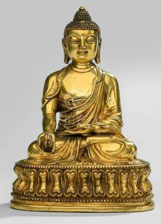 A GILT-BRONZE FIGURE OF BHAISAJYAGURU, Tibeto-Chinese, ca. 19th ct. - Property from a South German private collection, assembled prior 1990 - Minor wear, very slightly chipped