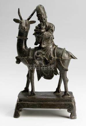 A BRONZE FIGURE OF SHOULAO RIDING A STAG, China, Kangxi period - Property from an Austrian private collection, acquired before 2016 - Minor wear
