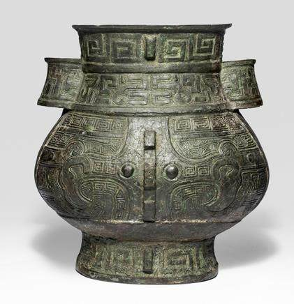 A HU-SHAPED BRONZE VASE IN ARCHAIC STYLE, China, probably Ming dynasty - Property from an old Diplomate collection, assembled in China prior 1970 - Repairs