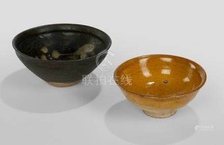 A JIZHOU BOWL WITH BLOSSOMING PLUM AND AN AMBER-GLAZED BOWL