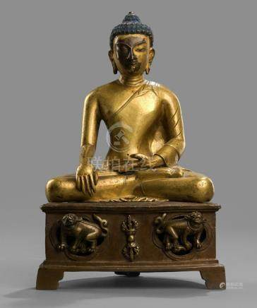 A PART-GILT BRONZE FIGURE OF BUDDHA SHAKYAMUNI SEATED ON A THRONE WITH LIONS