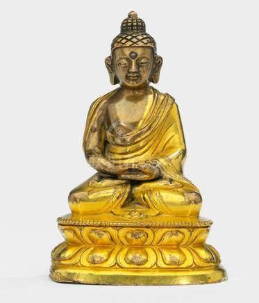 A PARCEL GILT-BRONZE FIGURE OF BUDDHA SHAKYAMUNI