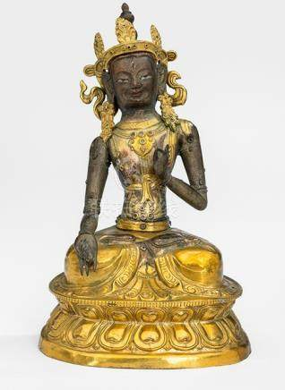 A PARCEL GILT-COPPER EMBOSSED FIGURE OF SITATARA