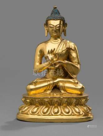 A GILT-BRONZE FIGURE OF BUDDHA SHAKYAMUNI ON A LOTUS BASE